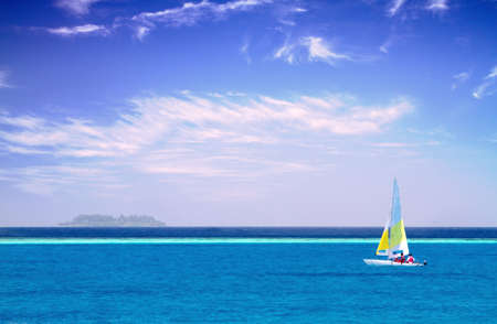 Photo of Sailboat in clear sky along Maldive coast Stock Photo