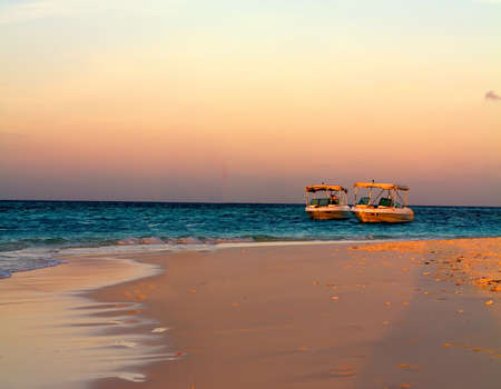 Photo of Sailboat along Maldive coastline in dusk