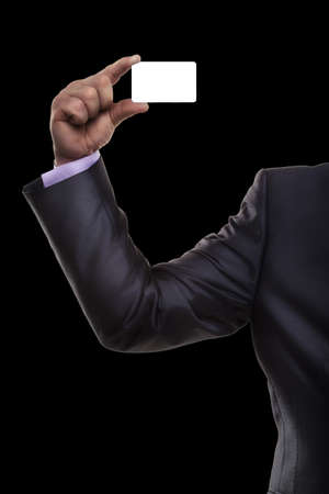 Blank business card in a hand Isolated on black background photo