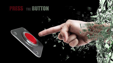 Hand press on big Red button out of cracked glass isolated on black background  photo