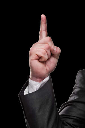 Businessmans hand showing sign isolated on black background High resolution  photo