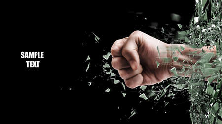 concept. power fist coming out of cracked glass isolated on black background