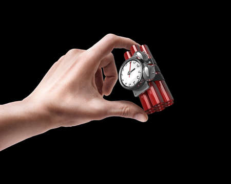 Man's hand holding Bomb with clock timer isolated on black background  photo