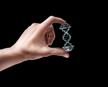 Mans hand holding capsule with Sample DNA isolated on black background photo