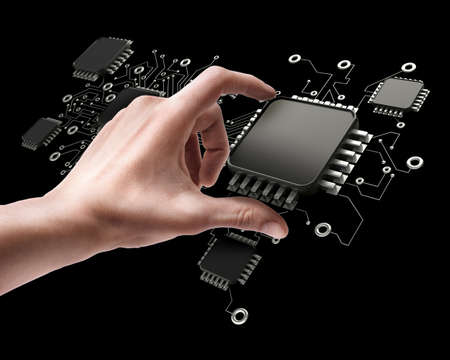 Mans hand holding CPU chip isolated on black background