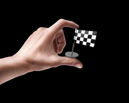 rally finger: Mans hand holding Checkered Flag isolated on black background  Stock Photo