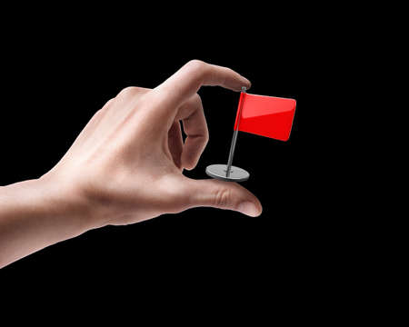 Mans hand holding Red flag isolated on black background photo