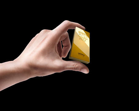Mans hand holding golden bar isolated on black background