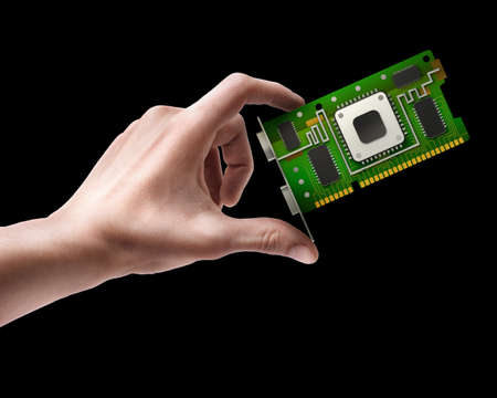 Man's hand holding graphic card GPU isolated on black background  photo