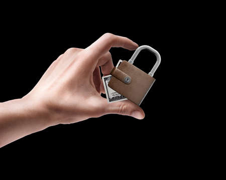 Man's hand holding Wallet lock isolated on black background  photo