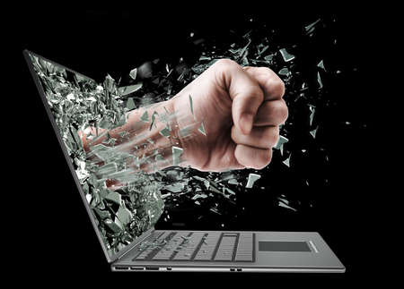 Fist from laptop. Isolated on black background High resolution Stock Photo - 20365971