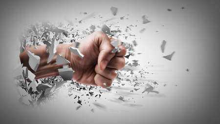 fist coming out of cracked ground  Stock Photo