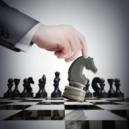 chess rook: Strategy concept. hand holding white chess figure on chess board