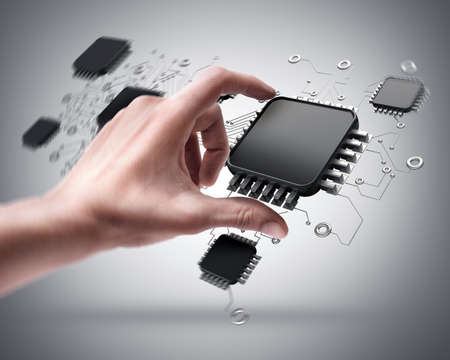 data processor: Mans hand holding CPU chip Stock Photo