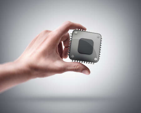 chip and pin: Mans hand holding CPU chip Stock Photo