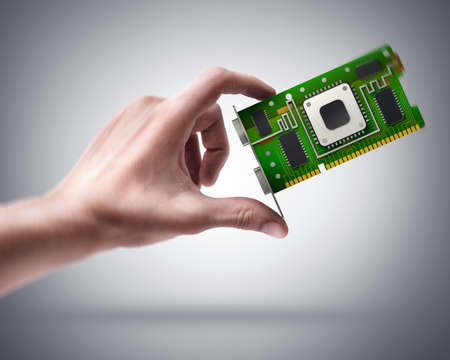 Man's hand holding graphic card GPU photo
