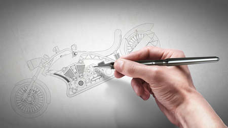 hand with the pencil drawing cad . engineer working on concept motorcycle  photo