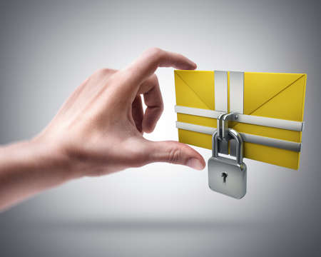 Mans hand holding Yellow mail and lock