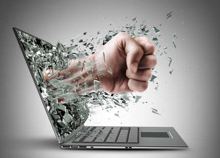 Fist from laptop. High resolution Stock Photo - 22211798