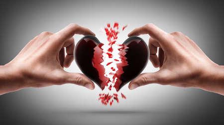 hands holding broken heart