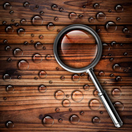 magnifying glass over wooden background High resolution  photo