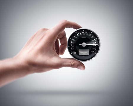 speeding: Mans hand holding Speedometer