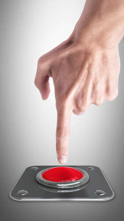 hand press on big Red button photo