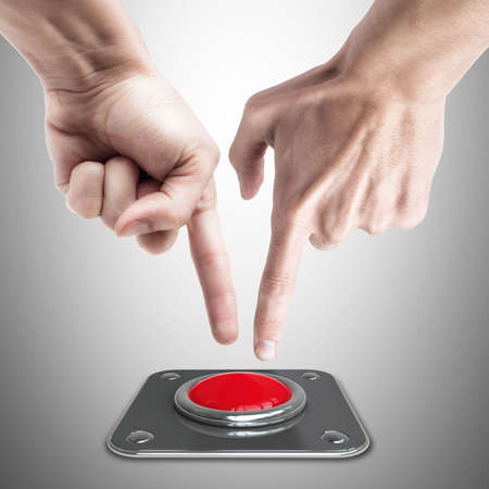 panic button: hand press on big Red button