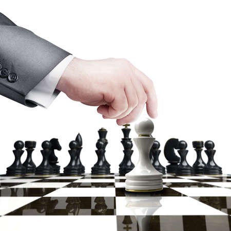 ability: Strategy concept. hand holding white chess figure on chess board  isolated on white background High resolution