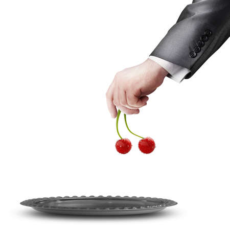 businessman hand holding cherries isolated on white background High resolution  photo