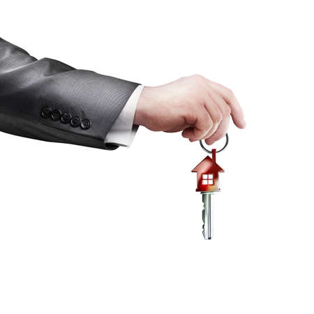 simbols: Key with red home shape in hand isolated on white background High resolution