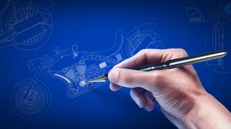 Hand and blueprint . engineer working on blue print concept  photo