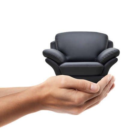 arm chair: Man hand holding object ( modern leather chair )  isolated on white background. High resolution  Stock Photo