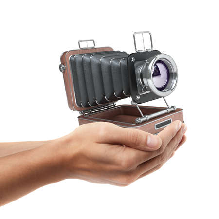 Man hand holding object ( Classic Retro Camera )  isolated on white background. High resolution  photo