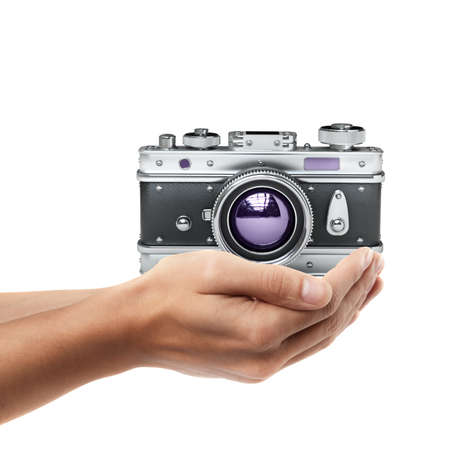 Man hand holding object ( Vintage silver photo camera )  isolated on white background. High resolution  photo