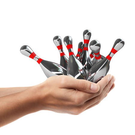Man hand holding object ( bowling pins )  isolated on white background. High resolution   photo