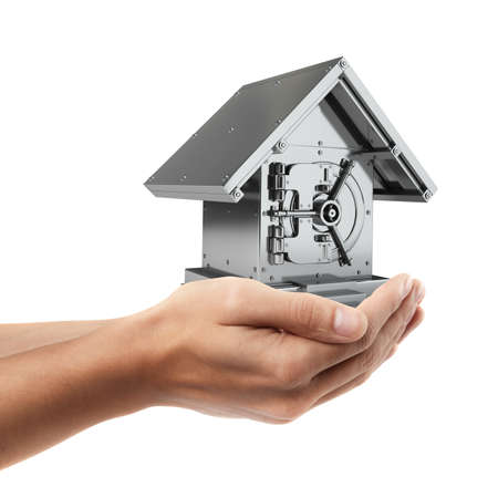 Man hand holding object ( Bank Safe in form houses )  isolated on white background. High resolution  photo