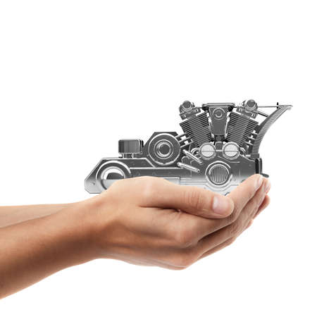 rally finger: Man hand holding object ( chromed motorcycle engine  )  isolated on white background. High resolution