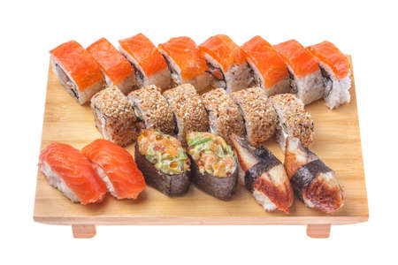 Big Sushi and roll set on wooden board isolated on white background  photo