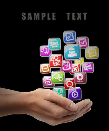 APPS icons. Man hand holding object isolated on black background. High resolution  photo
