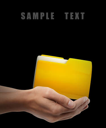 Yellow folder. Man hand holding object  isolated on black background. High resolution