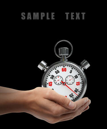 Stopwatch. Man hand holding object  isolated on black background. High resolution  photo