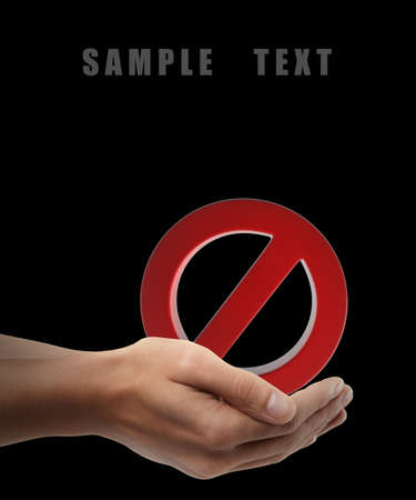 Red forbidden sign. Man hand holding object  isolated on black background. High resolution  photo