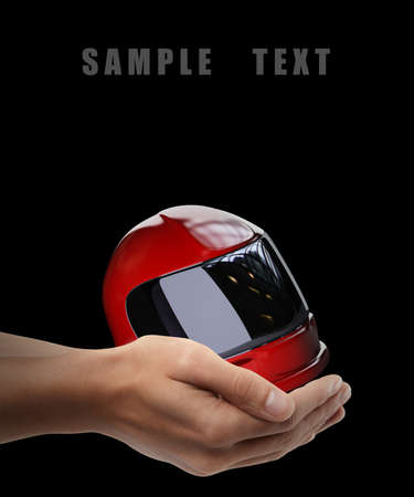 rally finger: Red moto helmet. Man hand holding object  isolated on black background. High resolution