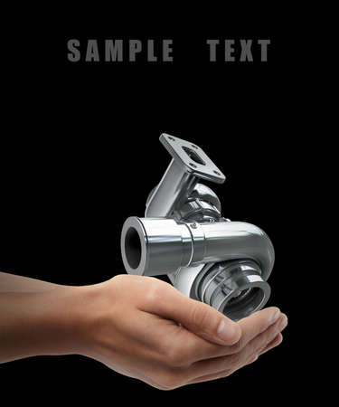 turbocharger: Steel turbocharger. Man hand holding object isolated on black background. High resolution  Stock Photo