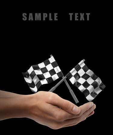 Two crossed checkered flags. Man hand holding object  isolated on black background. High resolution