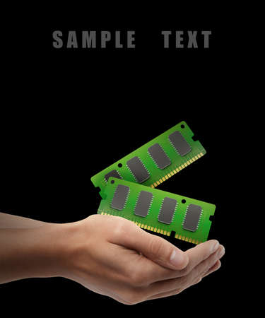 mb: RAM Memory Card. Man hand holding object isolated on black background. High resolution