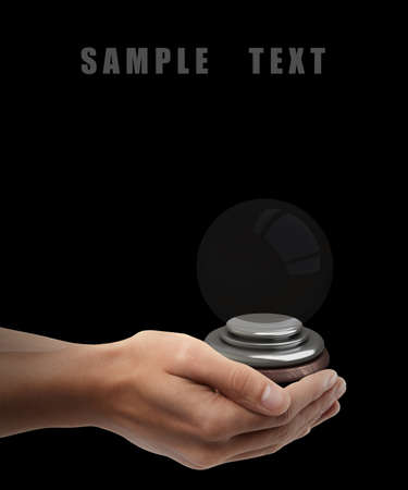 Man hand holding object ( empty crystal ball ) isolated on black background. High resolution  photo