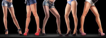 Lot of beautiful female legs isolated on black background. High resolution  Stock Photo