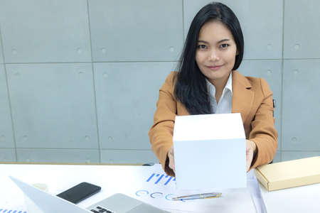 business woman get a package at workplace